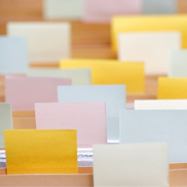 multicoloured post-it notes stuck to files